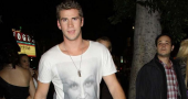 Liam Hemsworth excites fans with shirtless photos and fighting stories